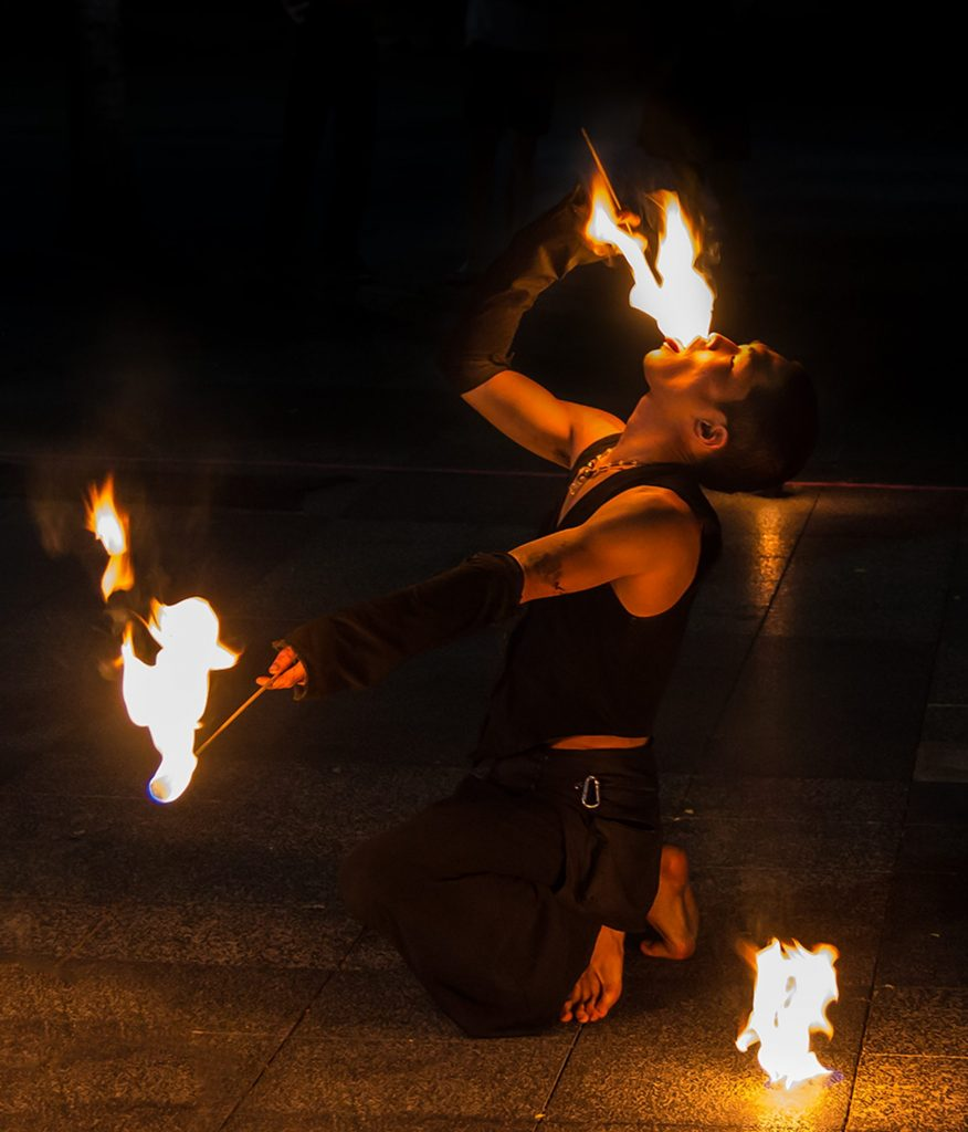 Photo of man eating fire