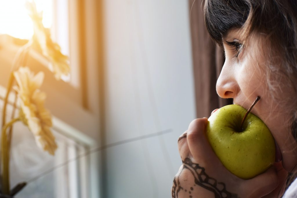 The five-minute favor shows that you're offering up a bite of your apple, just like the woman in this photo