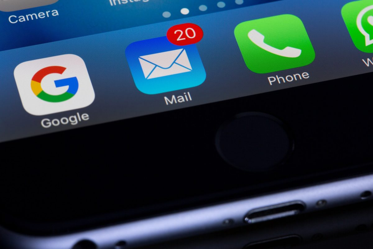 iPhone screen focusing on email app icon
